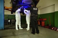 Police team working in ultraviolet light on collecting of traces and evidences stock photo