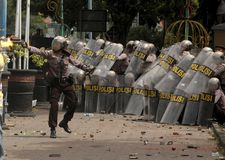 POLICE TEAR GAS. A police officer shoots tear gas on a riot in Sragen, Java, Indonesia Royalty Free Stock Photography