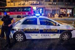 Police in Tel Aviv. Tel Aviv, Israel - October 18, 2015. Police officer stands next to police car on the street in Tel Aviv Stock Photography