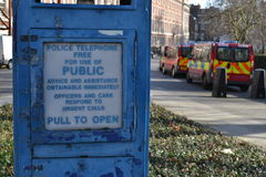 Police telephone booth police cars Stock Image
