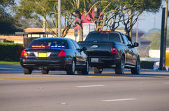 Police traffic stop. An unmarked police car has pulled over a truck for a traffic violation Stock Photo