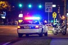 Police traffic stop at night. Motorcycle pulled over by police officer at night Royalty Free Stock Photography