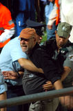 Police tries to hold a violent fan of Bnei Sakhnin. While other fans throw stones on Bnei-Yehuda fans Stock Image