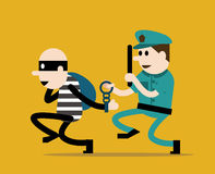 Police trying to catch a criminal. Royalty Free Stock Image