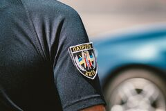 Police of Ukraine, badge of Ukrainian police close up. Police patrol Ukraine. Kiev. Chevron on the sleeve of a patrol