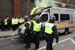 Police under Attack during a Riot in London. Riot police come under attack during a large austerity rally on March 26, 2011 in London, UK Royalty Free Stock Photos