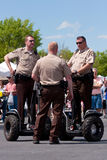 Police Use Segways To Get Around Festival Stock Photography