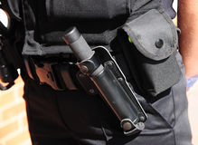 Police utility belt with batton (ASP). Police utility belt showing carriage of the issue police baton (night stick) called an ASP Stock Photo