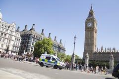 Police van drive past big ben in westminster Stock Photos