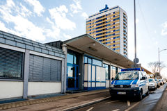 Police van in front of station and appartment building backgroun Royalty Free Stock Photos