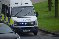 Police van mobile to incident. Police van mobile to an emergency incident on blue light royalty free stock photos