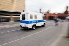Police van in motion Royalty Free Stock Image