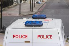 Police van at street of london. Police van at the streets of london in cloudy day royalty free stock photos