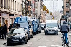 Police vans and officers securing surveilling Christmas Market i royalty free stock photography