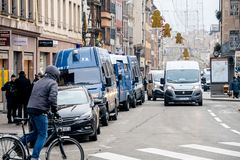 Police vans and officers securing surveilling Christmas Market i stock photos