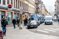 Police vans and officers securing surveilling Christmas Market i royalty free stock image