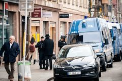Police vans and officers securing surveilling Christmas Market i royalty free stock photo