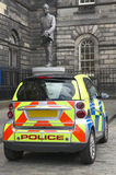 Police vehicle in Edinburgh city with old building Royalty Free Stock Photo