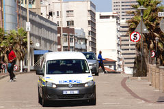 Police Vehicle Patrolling Street in Durban South Africa. DURBAN, SOUTH AFRICA - FEBRUARY 8, 2014: Police vehicle pattrols streets on Durban South Africas Golden royalty free stock photography