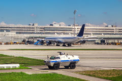 Police vehicle patrols airport in Munich. Royalty Free Stock Photos