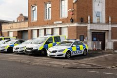 Police vehicles outside the Police station, UK. Police vehicles off duty outside a Police Station in the UK. Plans are being made for an increase in funding for royalty free stock image