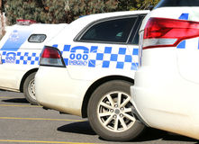 Police vehicles parked outside a police station Stock Photo