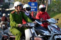 Police in Vietnam. Dalat, Vietnam – February 10, 2012: Member of Vietnamese Order Police on motorcycle on February 10, 2012 in Dalat, Vietnam. Musicians stock images