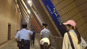 Police are walking through Hong Kong Cultural Centre. stock footage