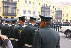 Police watching a parade, Stock Photography