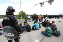 Police watching refugees Stock Photos