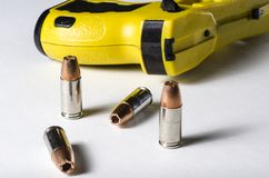 Police weapons. A close up of a police stun gun and bullets royalty free stock photography