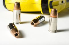Police weapons. A close up of a police stun gun and bullets stock photo
