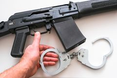 Police weapons and handcuffs lying on the table. Special operation of the police Department stock photography
