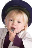 Police whistle. Young blonde girl paying with a police whistle Royalty Free Stock Images