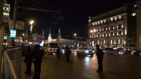 Police in winter clothes against the Kremlin stock video