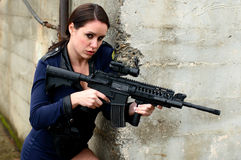 Police woman with assault rifle Royalty Free Stock Image