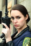 Police woman with assault rifle Stock Photography