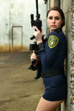 Police woman with assault rifle Stock Photo