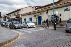 Police Woman directing traffic. Cusco, Peru - May 12 : Police woman directing traffic on a busy intersection at rush hour in Cusco. May 12 2016, Cusco Peru Stock Photography