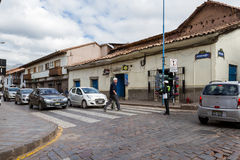 Police Woman directing traffic. Cusco, Peru - May 12 : Police woman directing traffic on a busy intersection at rush hour in Cusco. May 12 2016, Cusco Peru Royalty Free Stock Images