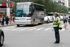 Police woman is directing traffic. New York, July 27, 2017: African American police woman is directing traffic during the day in Manhattan Stock Photo