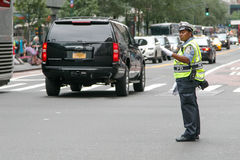 Police woman is directing traffic. New York, July 27, 2017: African American police woman is directing traffic during the day in Manhattan Royalty Free Stock Image
