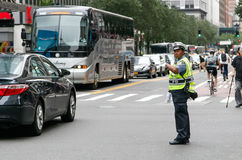 Police woman is directing traffic. New York, July 27, 2017: African American police woman is directing traffic during the day in Manhattan Stock Images