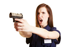 Police woman firing her weapon Stock Photo