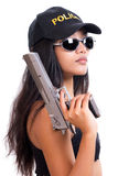 Police woman with a gun. On white background Royalty Free Stock Photography