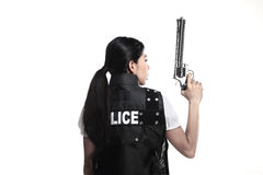 Police woman hold revolver gun. Isolated over white background Royalty Free Stock Images