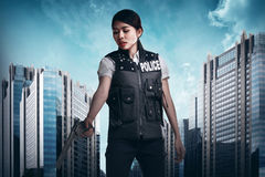 Police woman holding gun ready to fire royalty free stock photography