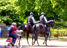 Police woman on horseback on  The Mall, street in front of Buckingham Palace in London. UK Stock Images