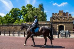 Police woman on horseback  opposite St. James Palace. Selective focus Royalty Free Stock Photo