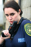 Police woman with pistol Royalty Free Stock Photography